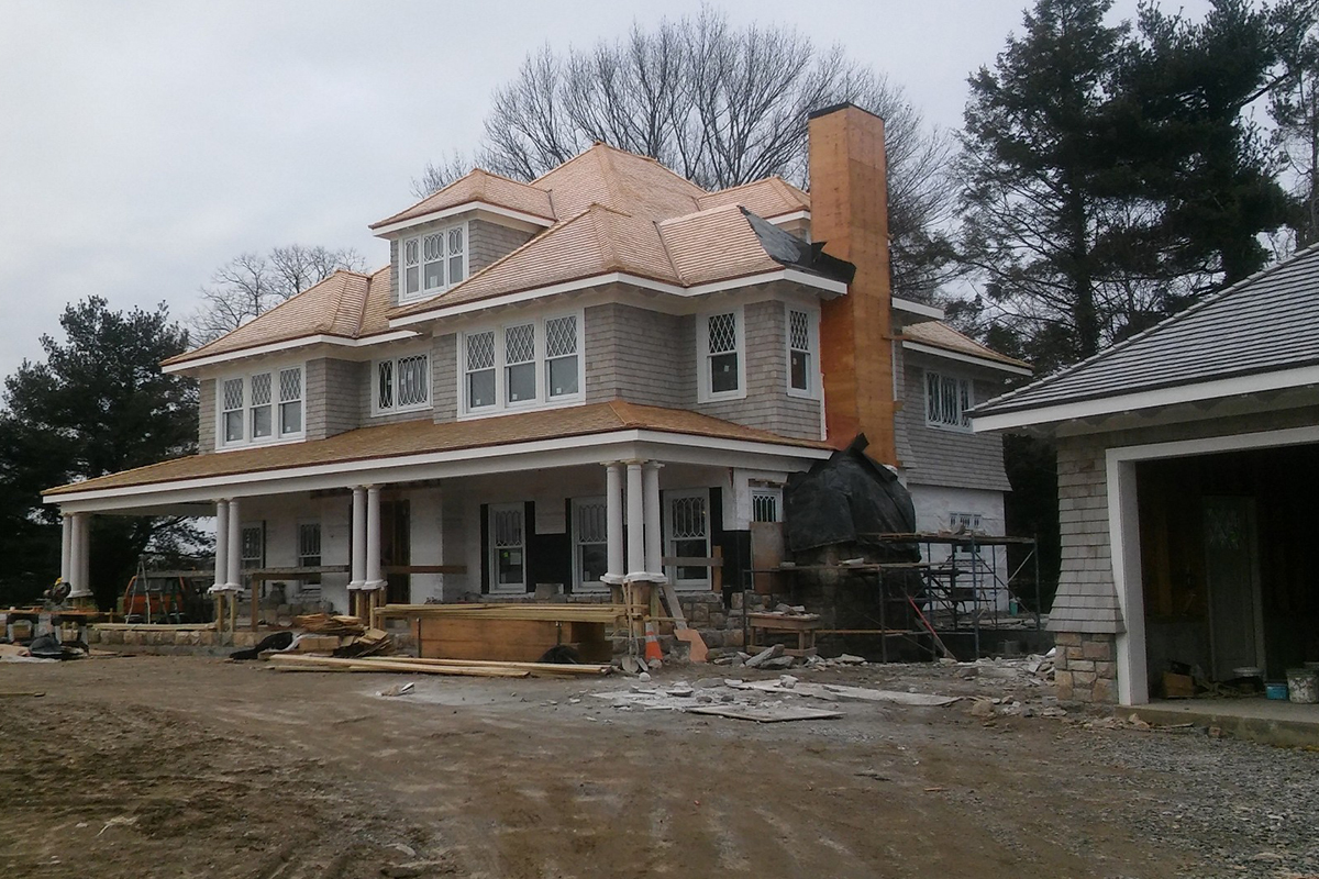 New home construction - roofing and exterior stone siding/chimney work from Highland Builders Corp. in Westchester and Fairfield Counties.